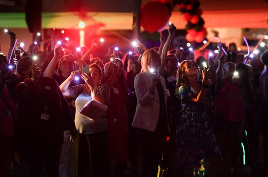 Guests wave flash lights to say goodnight to patients at Monroe Carell Jr. Children's Hospital at Vanderbilt after a thank you event for donors Tuesday.