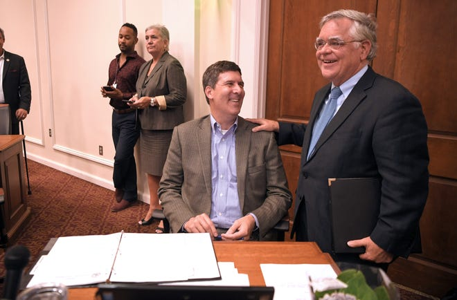 Mayor Cooper waits by At Large council member Bob Mendes' desk to be introduced to speak during the new council's first meeting at city hall on Oct. 1.