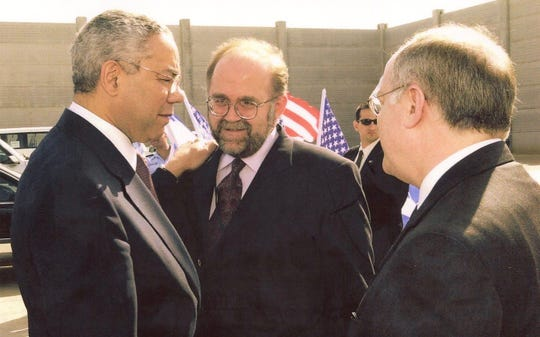 Ron Schlicher is pictured with former U.S. Secretary of State Colin Powell in an undated photo.