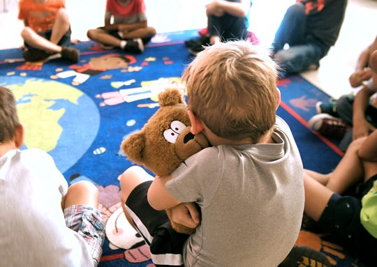 Liberty Elementary School first graders share details about their day, while holding a teddy bear during a lesson with school counselor Melissa McNabb on Sept. 30, 2019 .