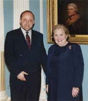 Ron Schlicher is pictured with former U.S. Secretary of State Madeleine Albright in an undated photo.