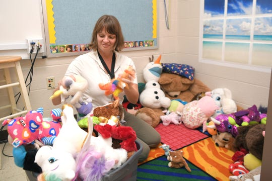 Liberty Elementary School counselor Melissa McNabb prepares the Peace Corner with stuffed animals in her classroom on Sept. 30, 2019.