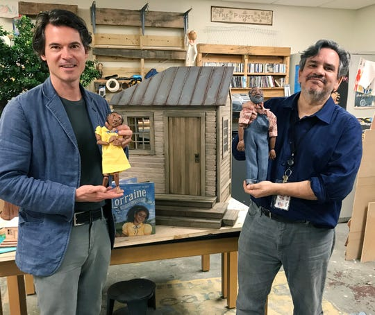 """Musician and author Ketch Secor, left, and puppeteer Brian Hull show off the puppets for the """"Lorraine"""" puppet show."""