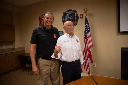 Estero Fire and Rescue Commissioner  Dick Schweers, right, talks with Estero Fire Chief Scott Vanderbrook after a Estero Fire Rescue Commission meeting, Tuesday, Sept. 25, 2019, in Estero.