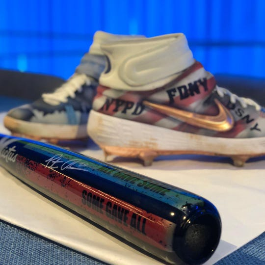 New York Mets rookie Pete Alonso donated the custom cleats and baseball bat used on Sept. 11 on Tuesday to National September 11 Memorial & Museum.