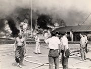Onlookers stand before the Palisades Amusement Park fire on August 13, 1944.