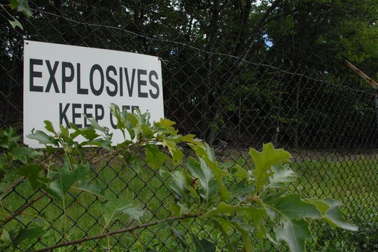 The former Hercules Explosives Manufacturing in Roxbury, still fenced, can be seen on the side of Howard Boulevard near Route 46.