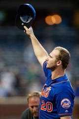 New York Mets' Pete Alonso, who set the MLB rookie home run record after surpassing the Yankees' Aaron Judge, waves to the crowd after he was removed from the Mets final baseball game of the season, Sunday, Sept. 29, 2019, in New York.