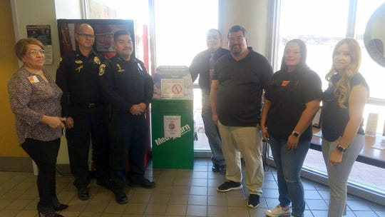 Pictured from left are Esther Aguirre-Stewart, Luna County Health Council Prevention Subgroup; Lt. Clint Hogan Deming Police Department; Deming Police Chief Alex Valdespino, Lt. Louis Tavizon, DPD; John Costilla-Gonzalez, Luna County Health Council Prevention Subgroup; Desa Malina, Luna County Health Council Prevention Subgroup; and Edith Vazquez, Luna County Health Council Prevention Subgroup.