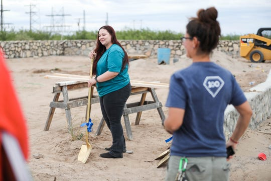 Brittany Medina breaks ground on her new home at an event for a Habitat for Humanity groundbreaking at a house site in Las Cruces on Tuesday, Oct. 1, 2019.