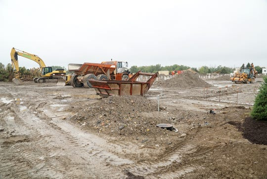The planned mix-use development on Haggerty between Seven and Eight will have retail locations near the road and work has begun on residences behind it - closer to I-275.