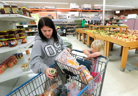 Nikita Henthorn of Oshkosh shops for groceries with her daughter Naomi Branham, 4, Wednesday, October 2, 2019, at the Oshkosh Area Food Pantry in Oshkosh, Wis.