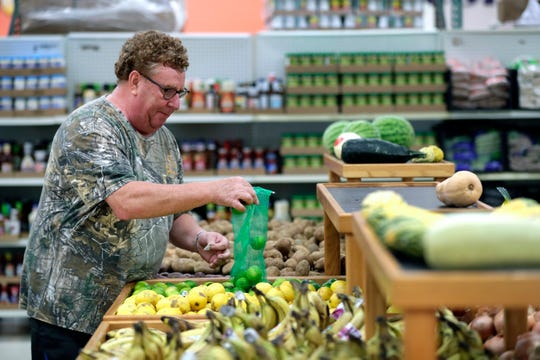 Volunteer Paul Benz of Oshkosh places limes in a food bin Wednesday, October 2, 2019, at the Oshkosh Area Food Pantry in Oshkosh, Wis.Dan Powers/USA TODAY NETWORK-Wisconsin