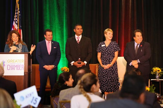 Mayor Linda Evans makes closing remarks as council members Robert Radi, Steve Sanchez, Kathleen Fitzpatrick and John Pena look toward the audience during the La Quinta State of the City and Business Awards luncheon at Embassy Suite in La Quinta, Calif., on Wednesday, October 2, 2019.