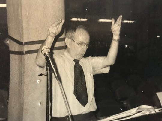 Dr. John Norman directs the College of the Desert choir in the early 1980s.