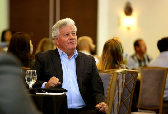 Robert Green, president and CEO of The Robert Green Company, waits for his turn to speak about future developments at SilverRock Resort during the La Quinta State of the City and Business Awards luncheon at Embassy Suite in La Quinta, Calif., on Wednesday, October 2, 2019.