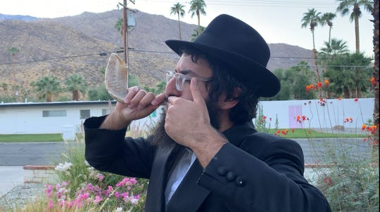 Rabbi Boz Werdiger of Chabad Palm Springs blows his shofar to greet the new year near his synagogue on Rosh Hashannah, Sept. 29, 2019, shortly before the customary time to do tashlich.