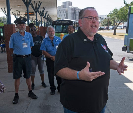 Mike Lowery, president of the Amalgamated Transit Union Local 1395 that represents ECAT workers, holds a press conference Wednesday outside ECAT's Rosa L. Parks Transit Complex.