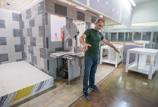 Owner Ray Sehweil  shows where the meat counter will be at the new location of Taste of Jerusalem on W Cervantes Street in Pensacola on Wednesday, October 2, 2019.  Sehweil is in the process of moving from his current location on Pace Blvd. to the former location of Oscar's restaurant/Uncle Billy's Antique Mall.