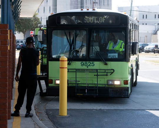 An ECAT driver waits for passengers Wednesday outside the Rosa L. Parks Transit Complex.