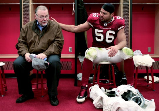 Arizona Cardinals owner Bill Bidwill and Chike Okeafor sit in the locker room after winning NFC West by defeating St. Louis Rams at University of Phoenix Stadium in Glendale in 2008.