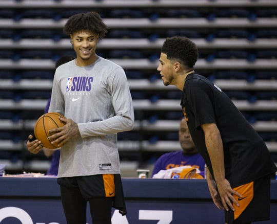 Forward Kelly Oubre laughs with guard Devin Booker during Phoenix Suns practice at the Rolle Activity Center at Northern Arizona University in Flagstaff, Wednesday, October 2, 2019.