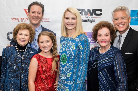 Elizabeth Smart (center) with 12-year-old Rosevelt Rawls, Childhelp founders Yvonne Federson and Sara O'Meara, Rosevelt's dad Jef Rawls and Fox 10 weatherman and emcee Cory McClosky.