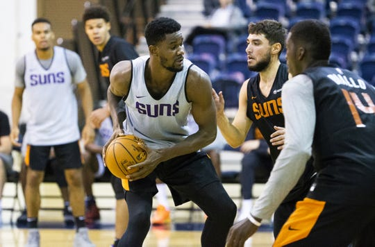Suns center Deandre Ayton works with the ball during a training camp practice at the Rolle Activity Center on Oct. 2 at Northern Arizona University.