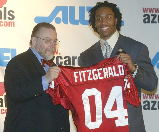 Arizona Cardinals owner Bill Bidwell with Larry Fitzgerald after Fitzgerald was drafted by the Cardinals in 2004.