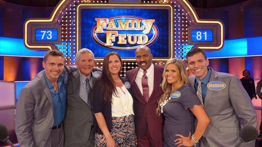 The Watkins family with Steve Harvey at a filming of Family Feud
