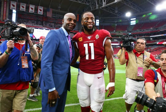 Jerry Rice greets Arizona Cardinals wide receiver Larry Fitzgerald (11) after Fitzgerald became number two for NFL all-time receptions at 1,326 against the Seattle Seahawks during a game on Sep. 29, 2019 in Glendale, Ariz. Jerry Rice holds the record at 1,549 NFL all-time receptions.