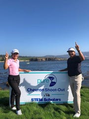 Sept. 26, 2019; Ashley Menne takes a photo with PGA Golf Tour champion Estaban Toledo after winning the Chevon Shoot-Out for STEM Scholars competition at PURE Insurance Championship at Pebble Beach Impacting the First Tee.