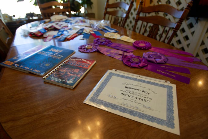 Mary Jane McHenry shows off her awards, on September 30, 2019. She won them competing in the Arizona State Fair's cooking contest 45 years in a row.