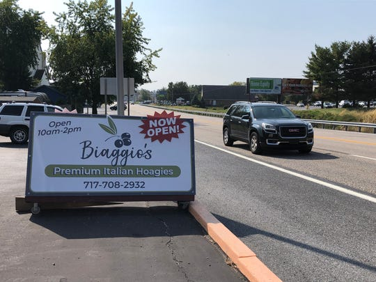 A sign along Route 422 lets drivers know there's a new hoagie shop in Lebanon.
