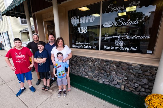 Steve and Nancy Neiman, photographed with their sons Zachary, 21, left of center; Steven, 12, left; Van, 10, center, and Will, 6, right, have been working to turn the space at 428 Broadway St. in Marine City into Bistro 428. Steve and Nancy have been catering to local first responders and schools and are opening their first storefront.