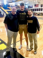 Port Huron Northern senior Braiden McGregor received his Under Armour All-America Game uniform during Friday's homecoming pep rally.