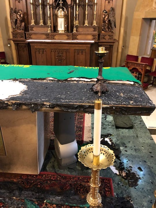The damage to a second alter after an arsonist set fire to two alters Tuesday morning at St. Mary's Catholic Church in St. Clair