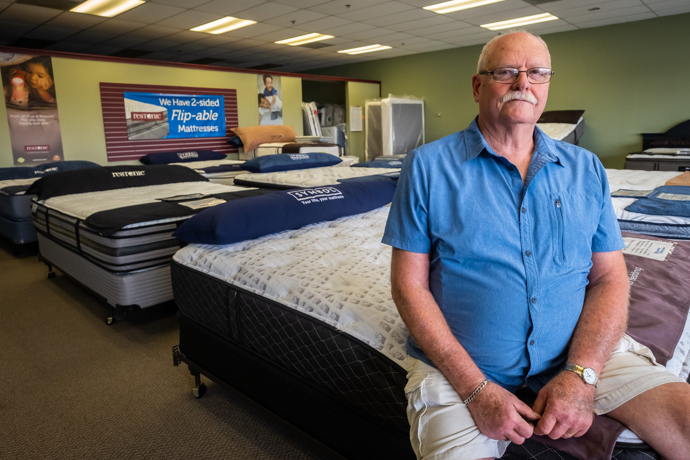 Dan Rich, who owns Trezure Hunt, sits in the store's mattress department for a photo Tuesday, Oct. 1, 2019. Trezure Hunt, which sells new and higher-end used furniture, was one of the first tenants in the Market Square strip mall in Marysville.