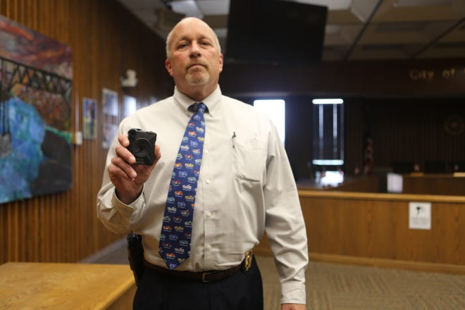 City of Poughkeepsie Police Chief Thomas Pape holding one of the 65 police body cameras.