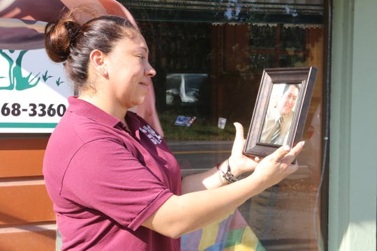 Aracelli Parra stands outside her restaurant, Coyote Flaco, where her husband was killed by state police.