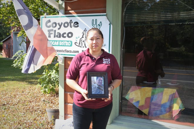 Aracelli Parra stands outside her restaurant, Coyote Flaco, where her husband was killed in a state police shooting.