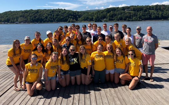 """The Marist College crew team poses before Morgan Zuch's """"Go the Extra Mile"""" walk last month."""