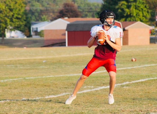 New Oxford senior quarterback Brayden Long drops back to throw a pass during practice. Long leads the York-Adams League with 1,427 passing yards and 15 touchdowns.