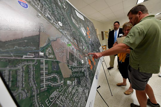 Jason Flohr from Edris Oil Services in North York looks at a map outlining the proposed Interstate 83 widening project to see who it will effect his business during a public meeting detailing the Environmental Assessment of the project, Tuesday, October 1, 2019 at Central York Middle SchoolJohn A. Pavoncello photo