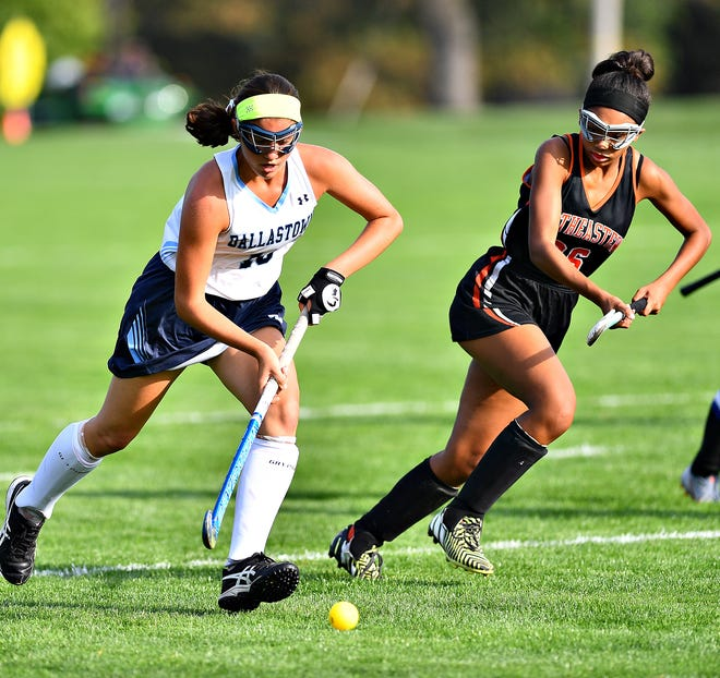 Dallastown's Camryn Eveler, left, and Northeastern's Jasmine Herod battle for control of the ball during field hockey action at Dallastown, Wednesday, Oct. 2, 2019. Dawn J. Sagert photo