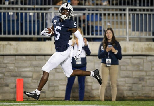 Penn State Nittany Lions wide receiver Jahan Dotson (5) runs the ball into the end zone for a touchdown during the fourth quarter against the Buffalo Bulls at Beaver Stadium.