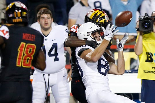 Sep 27, 2019; College Park, MD, USA; Penn State Nittany Lions wide receiver Dan Chisena (88) catches the ball while being interfered with by Maryland Terrapins defensive back Kenny Bennett (24) in the first quarter at Capital One Field at Maryland Stadium. Mandatory Credit: Geoff Burke-USA TODAY Sports