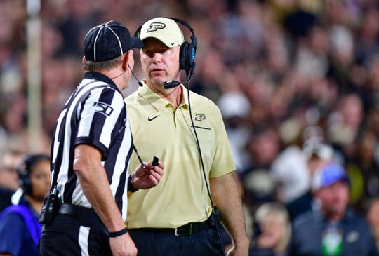 Sep 14, 2019; West Lafayette, IN, USA; Purdue Boilermakers head coach Jeff Brohm talks to a referee during the second half the game at Ross-Ade Stadium. The TCU Horned Frogs defeated the against the Purdue Boilermakers 34 to 13.  Mandatory Credit: Marc Lebryk-USA TODAY Sports