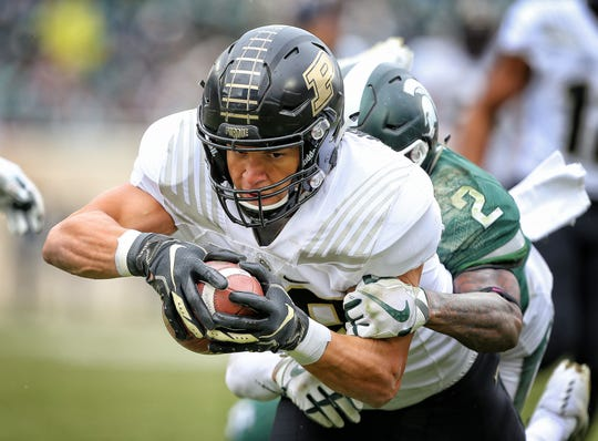 Oct 27, 2018; East Lansing, MI, USA; Purdue Boilermakers tight end Brycen Hopkins (89) runs for yards after a catch against Michigan State Spartans cornerback Justin Layne (2) during the second half at Spartan Stadium. Mandatory Credit: Mike Carter-USA TODAY Sports
