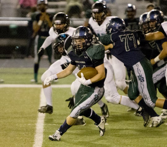 Damonte Ranch's  Sam Banghart runs against North Valleys during their football game played on Sept. 26, 2014